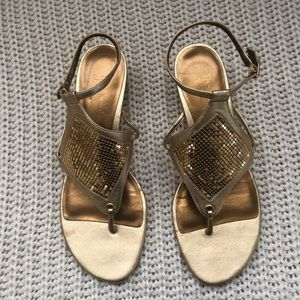 The touch of Nina Gold sandals used only once